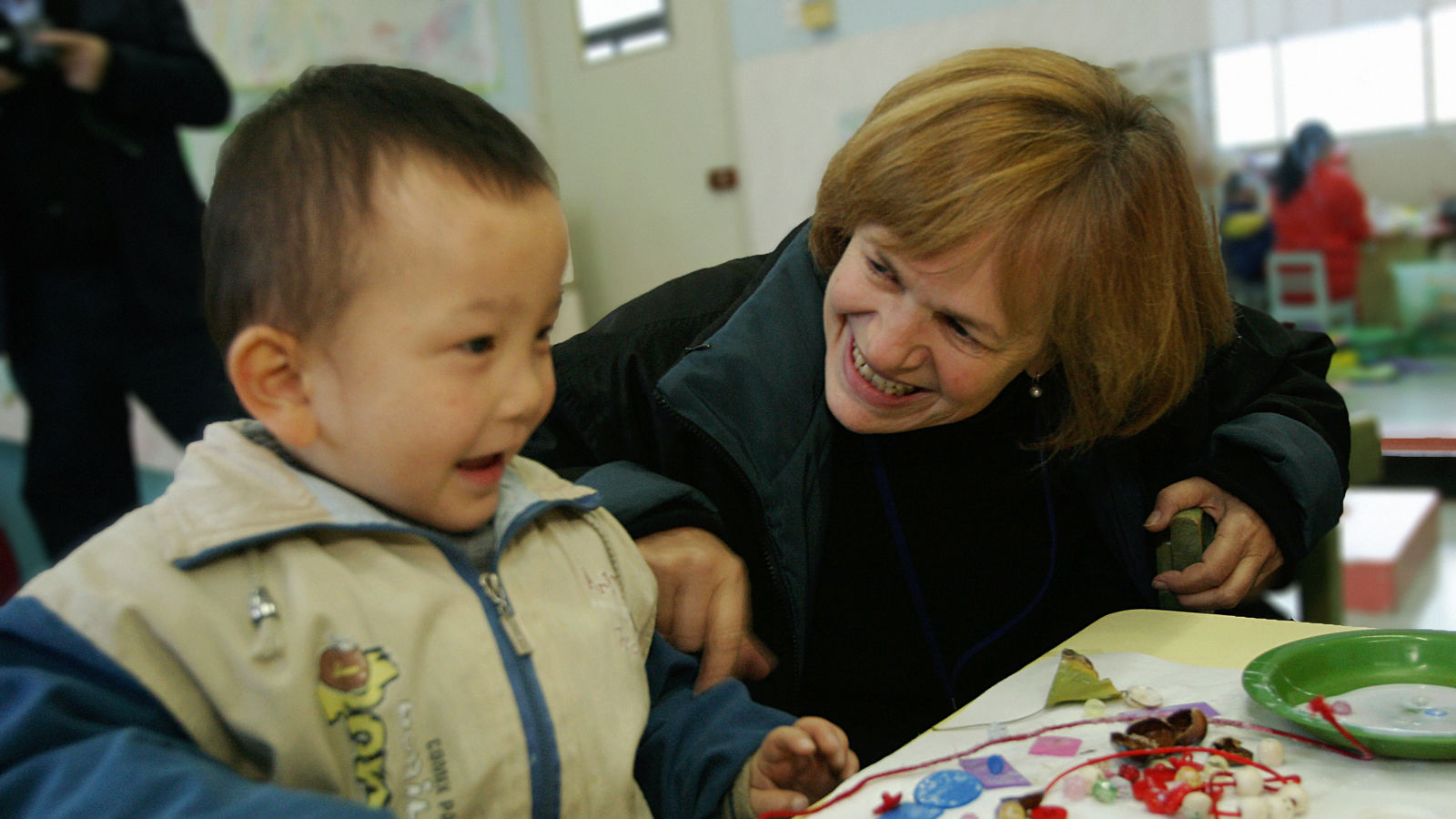 Jenny Bowen with a child at the Half the Sky Preschool Program in Anhui, China.